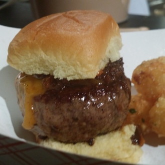 Oozy Juciy Lucy: Cheese Sauce Stuffed Beef Burger, Tomato Onion Bacon Jam with Truffle Tots