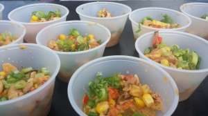 CRAWFISH MAQUE CHOUX with CORN CRAWFISH ,BACON,PEPPERS and CREOLE SEASONINGS