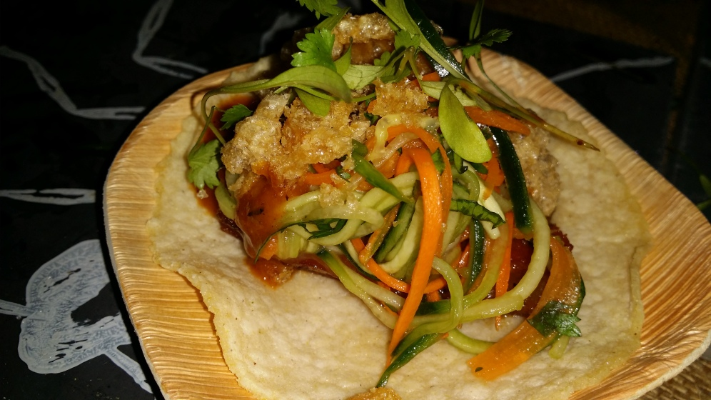The Black Ant Moo Krob Taco: Crispy Pork Belly, Chicharron, Pickled Cucumbers, Carrots, Cilantro, and Nam-Prik Pao BBQ