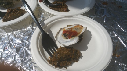 PIERRE THIAM CATERING Grilled Island Creek Oysters Smoked Crayfish Mignonette and Cassava Leaves with Paenuts